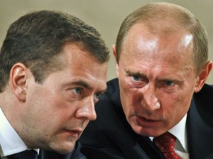 lizard creature putin whispering to his puppet medvedev